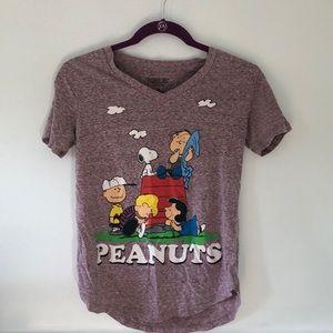 A purple Peanuts t-shirt